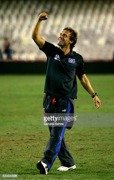 Coach Thomas Doll of Hamburger SV celebrates the victory during the Intertoto Cup Final between FC Valencia and Hamburger SV on August 23, 2005 at...
