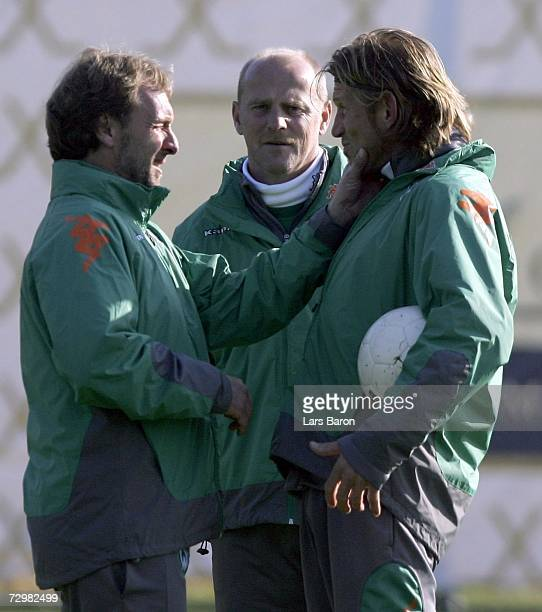 Coach Thomas Schaaf jokes with the assistant coaches Matthias Hoenerbach and Michael Kraft during the Werder Bremen training camp on January 12 2007...