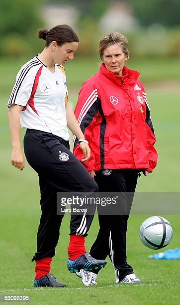 Coach Tina Theune Meyer speaks to Birgit Prinz during the training session of the German National Team at the UEFA Women Championships on June 17...