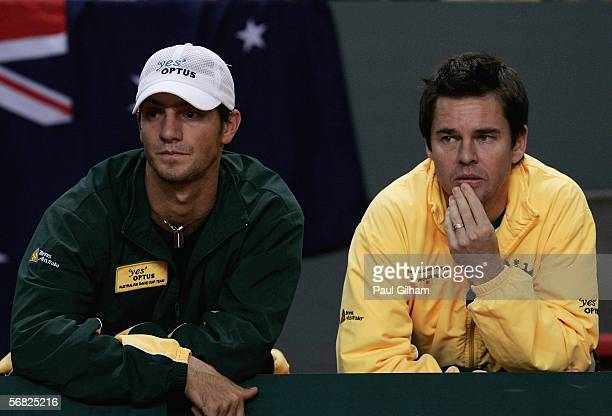 Coach Todd Woodbridge and hitting partner Marc Kimmich watch from the side of the court during the third rubber between doubles pair Yves Allegro and...