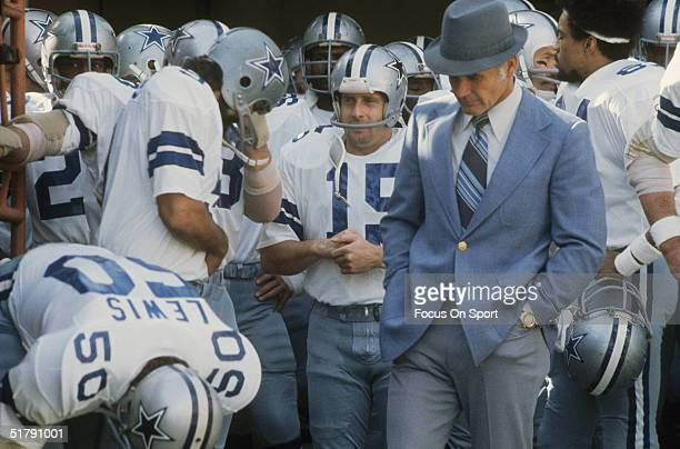 Coach Tom Landry of the Dallas Cowboys leads Drew Pearson DD Lewis Tony Fritsch and the rest of his team to the field circa 1970's Tom Landry coached...