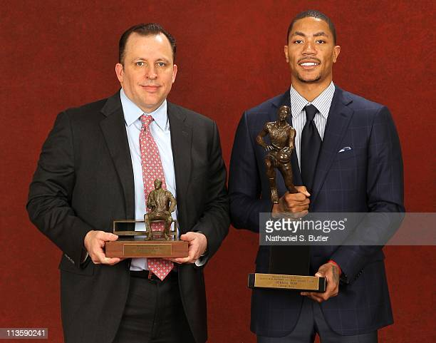 Coach Tom Thibodeau of the Chicago Bulls poses with the 201011 Kia NBA Coach of the Year Award alongside Derrick Rose with the Kia NBA Most Valuable...