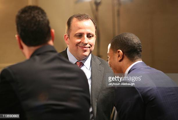 Coach Tom Thibodeau smiles at player Derrick Rose of the Chicago Bulls during a press conference to announce Rose winning the 201011 Kia NBA Most...