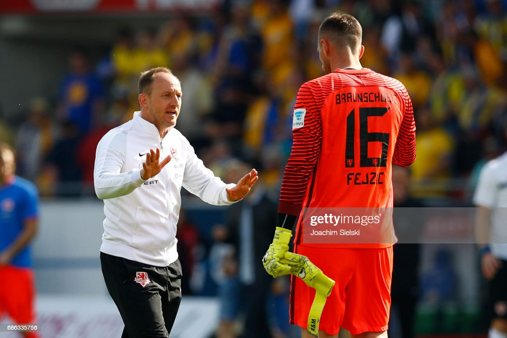 Coach Torsten Lieberknecht and Jasmin Fejzic of Braunschweig after the Second Bundesliga match between Eintracht Braunschweig and Karlsruher SC at Eintracht Stadion on May 21, 2017 in Braunschweig, Germany.