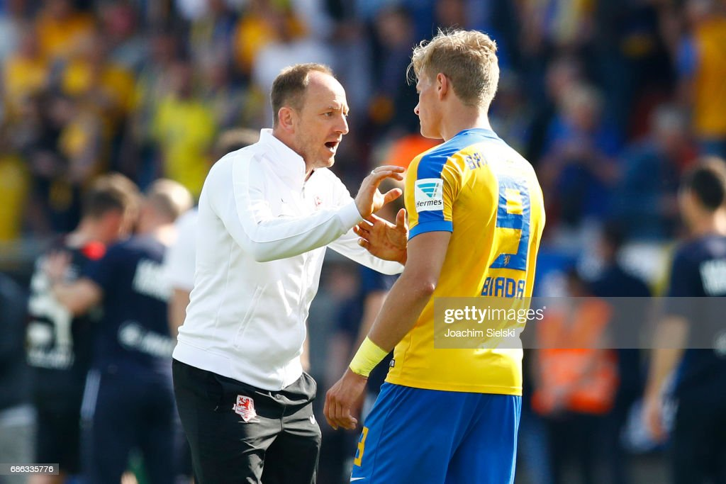 Coach Torsten Lieberknecht and Julius Biada of Braunschweig after the Second Bundesliga match between Eintracht Braunschweig and Karlsruher SC at Eintracht Stadion on May 21, 2017 in Braunschweig, Germany.