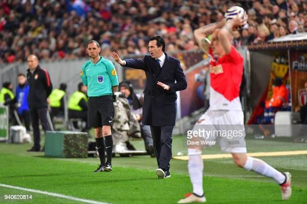PSG coach Unai Emery gives instructions as Andrea Raggi of Monaco takes a throwin during the Final of the French League Cup between Paris Saint...