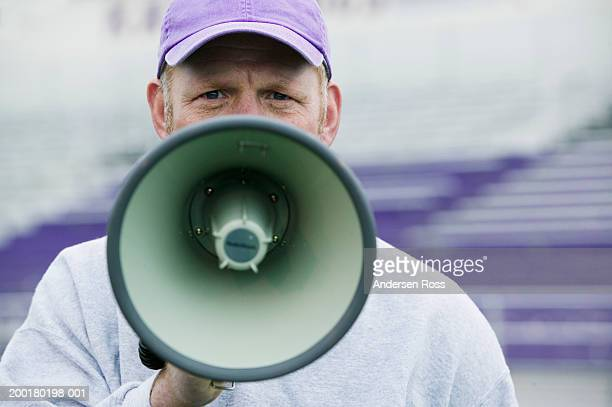 Coach using megaphone, portrait