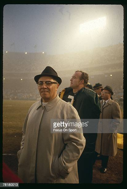 Coach Vince Lombardi of the Green Bay Packers watches play from the sideline during a circa 1960s NFL game at Lambeau Field in Green Bay Wisconsin...