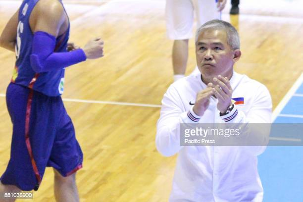 Coach Vincent Chot Reyes of the Philippines reacts after his players made a good account for themselves defeating Chinese Taipei 9083 during their...