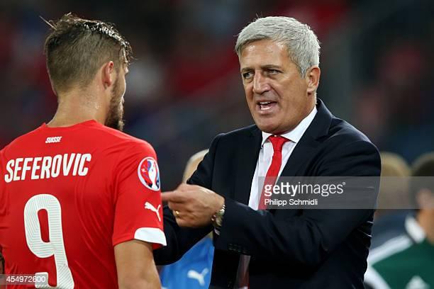Coach Vladimir Petkovic of Switzerland speaks with Haris Seferovic during the EURO 2016 Qualifier match between Switzerland and England on September...