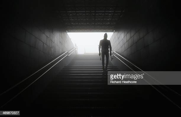 A coach walks down a tunnel as the race is delayed due to fog and poor visablity at the Men's 15 km Mass Start during day ten of the Sochi 2014...