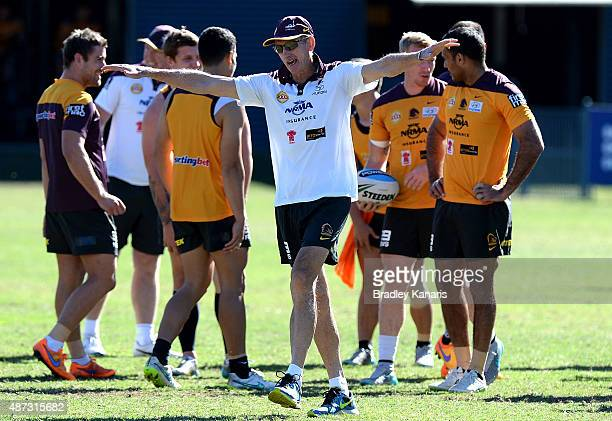 Coach Wayne Bennett enjoys a moment with his players during a Brisbane Broncos NRL training session on September 9 2015 in Brisbane Australia