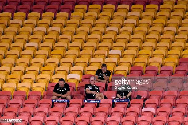 Coach Wayne Bennett of the Rabbitohs and his coaching staff watch on during the round 2 NRL match between the Brisbane Broncos and the South Sydney...