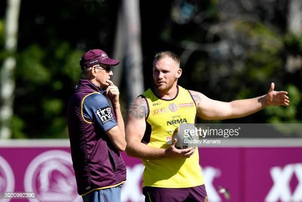 Coach Wayne Bennett talks tactics with Matt Lodge during a Brisbane Broncos NRL training session on August 22 2018 in Brisbane Australia