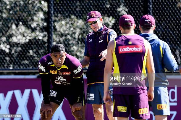 Coach Wayne Bennett talks tactics with Tevita Pangai during a Brisbane Broncos NRL training session on August 22 2018 in Brisbane Australia