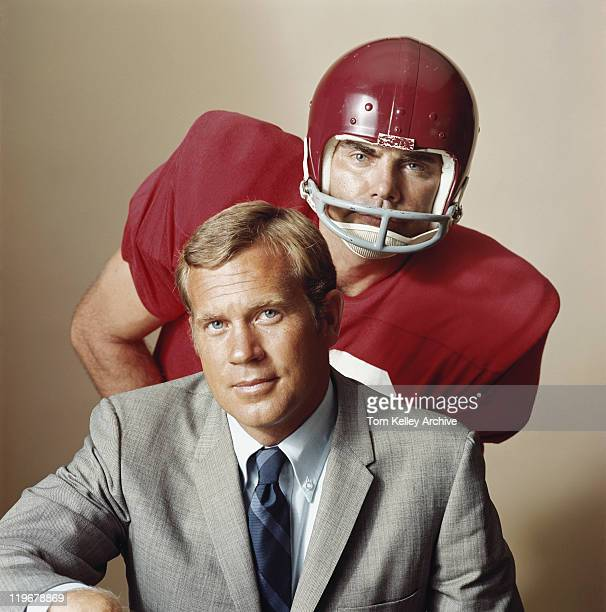 coach with american football player, portrait - archival stock pictures, royalty-free photos & images