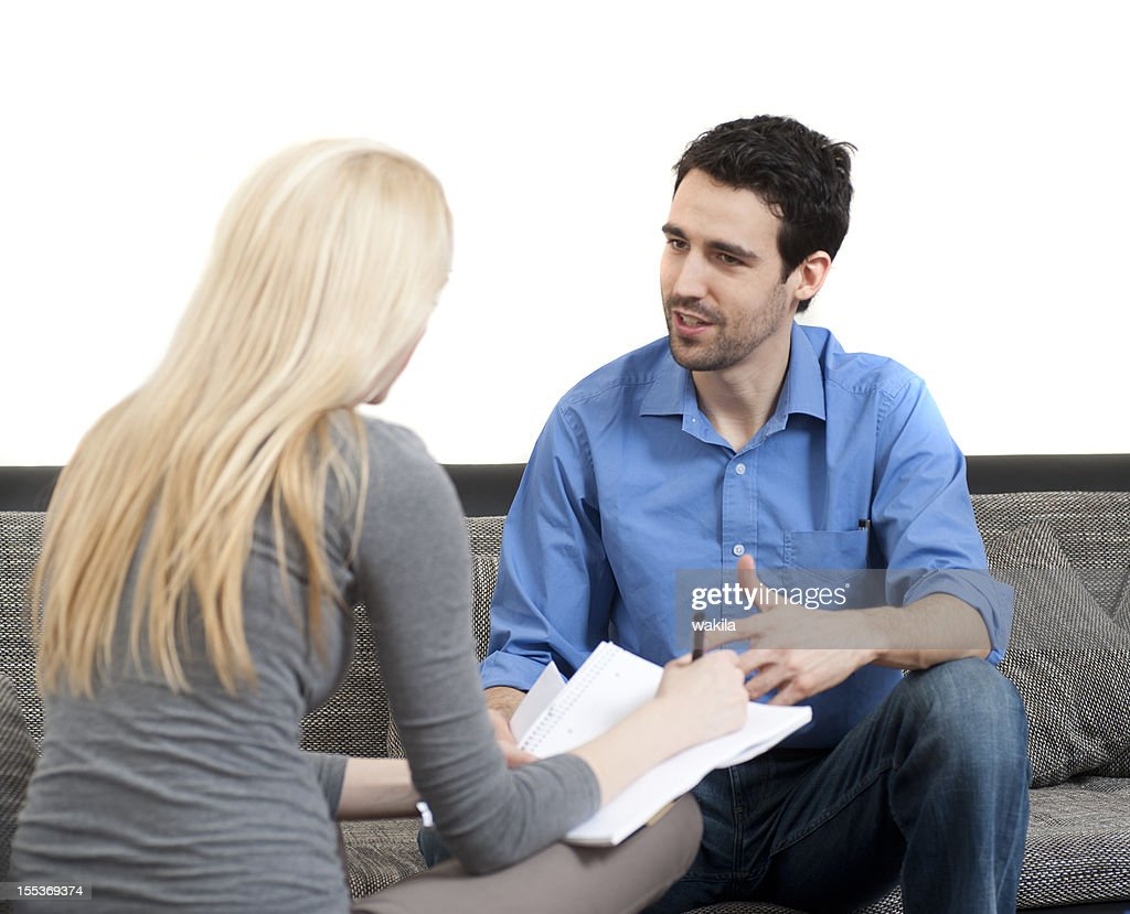 Coach with is debating, coaching about work on a couch : Stock Photo