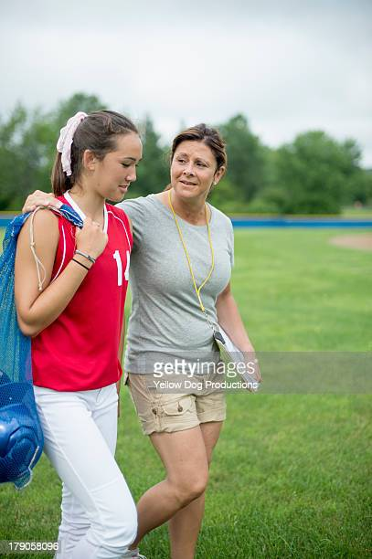 Coach with Teen Girl Softball Player