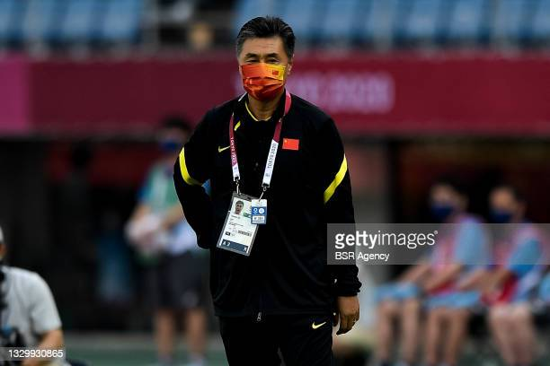 Coach Xiuquan Jia of China during the Tokyo 2020 Olympic Football Tournament match between China and Brazil at Miyagi Stadium on July 21, 2021 in...