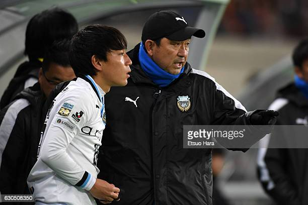 Coach Yahiro Kazama of Kawasaki Frontale instructs his player during the 96th Emperor's Cup quarter final match between FC Tokyo and Kawasaki...