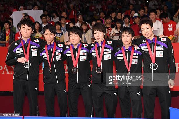 Coach Yosuke Kurashima, Masato Shiono, Seiya Kishikawa, Kenta Matsudaira, Koki Niwa and Jun Mizutani of team Japan pose with bronze medal during day...