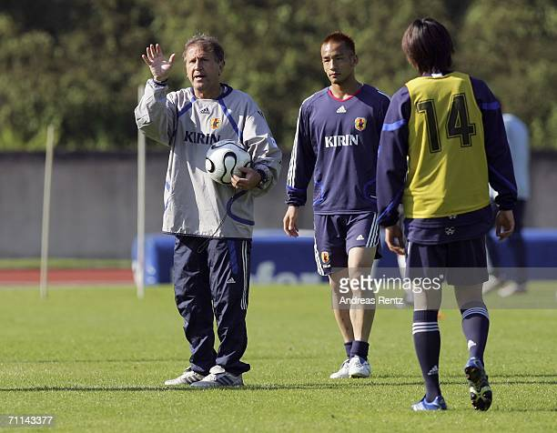 Coach Zico gestures as Hidetoshi Nakata looks on during the training session of Japan National Football Team on June 7 2006 in Bonn Germany Japan...