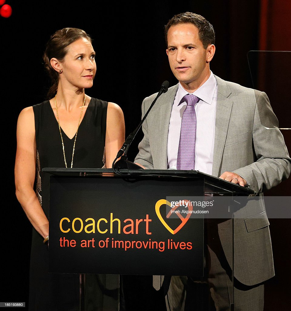 CoachArt President/Co-founder Zander Lurie (R) and CoachArt Co-founder Leah Bernthal speak onstage during CoachArt's 9th Annual 'Gala Of Champions' at The Beverly Hilton Hotel on October 17, 2013 in Beverly Hills, California.