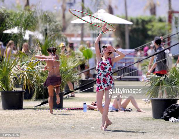 Coachella music fans play with Hula hoop's during Day 2 of the Coachella Valley Music & Arts Festival 2011 held at the Empire Polo Club on April 16,...