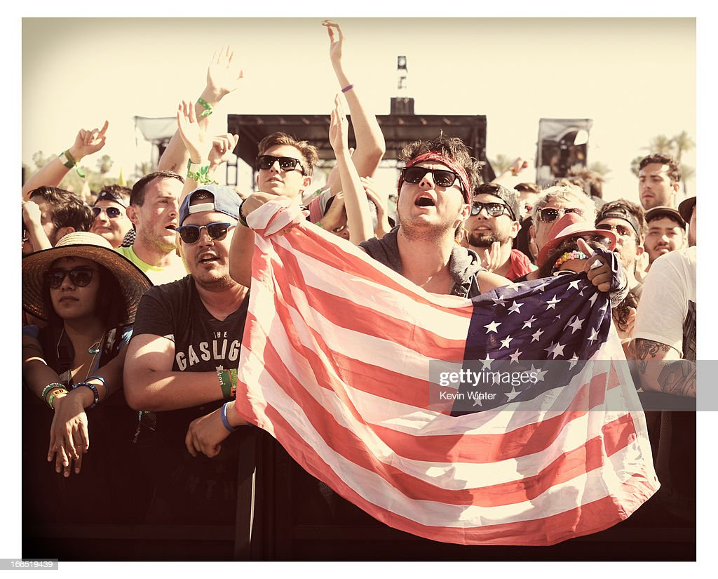 Coachella music fans watch the band Dropkick Murphys perform during day 1 of the 2013 Coachella Valley Music & Arts Festival at the Empire Polo Club on April 13, 2013 in Indio, California.