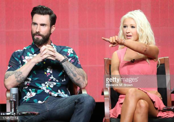 Coaches Adam Levine and Christina Aguilera speak onstage during 'The Voice' panel discussion at the NBC portion of the 2013 Summer Television Critics...