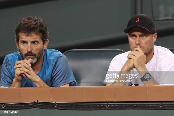 Coaches Adolfo Gutierrez and Lleyton Hewitt watch Alex De Minaur of Australia play Juan Martin Del Potro of Argentina during the BNP Paribas Open at...
