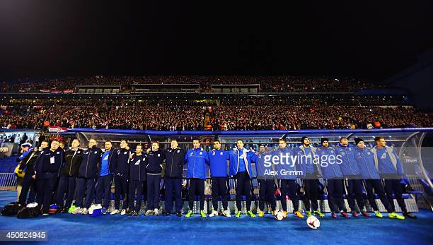 Coaches and substitution players of Iceland sing their national anthem prior to the FIFA 2014 World Cup Qualifier playoff second leg match between...