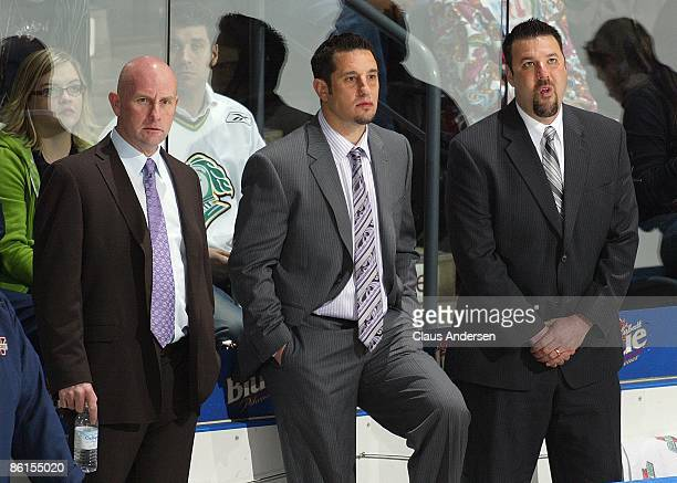 Coaches Bill Dark Bob Boughner and Bob Jones of the Windsor Spitfires watch the warmup prior to Game Two of the Western Conference Championship...
