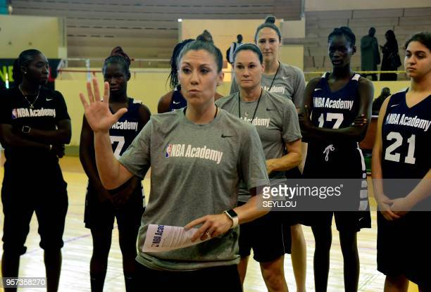 US coaches Blair Hardiek speaks watched by fellow coach Jennifer Azzi and players Senegal's Mame DC Thiaw and Egypt's Jana HAbdullah as they take...