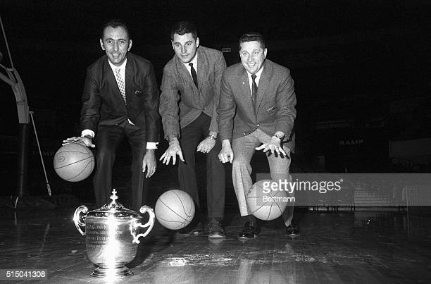 Coaches Bob Cousy of Boston College Bobby Knight of Army and Ray Mears of Tennessee dribble towards the trophy each hopes to take back to his campus...
