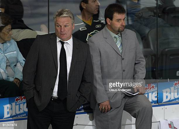 Coaches Dale Hunter and Jacques Beaulieu of the London Knights watch during a game against the Mississauga St Michaels Majors on September 25 2009 at...