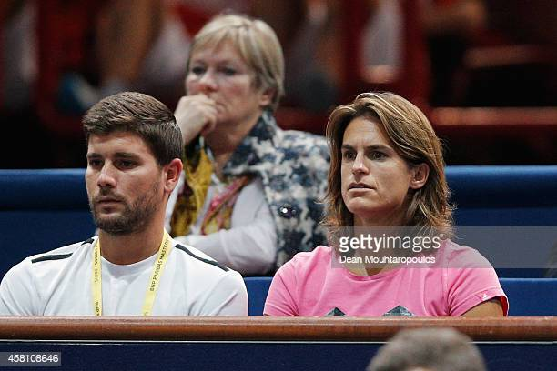 Coaches Daniel Vallverdu and Amelie Mauresmo watch their player Andy Murray of Great Britain play against Grigor Dimitrov of Bulgaria during day 4 of...