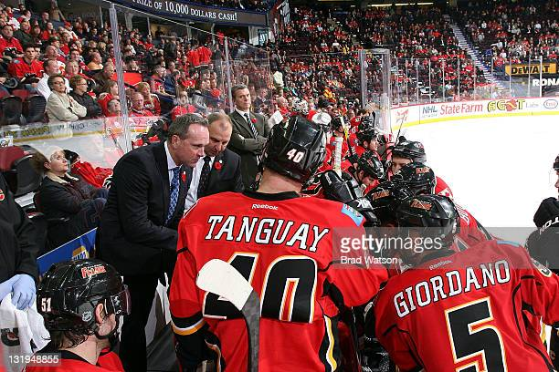 Coaches Dave Lowry and Brent Sutter instruct Alex Tanguay Mark Giordano and teammates of the Calgary Flames during a timeout against the Minnesota...