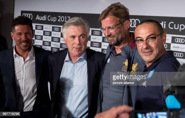 Coaches Diego Simeone of Atletico Madrid Carlo Ancelotti of Bayern Munich Jurgen Klopp of Liverpool and Maurizio Sarri of Napoli taking part in a...