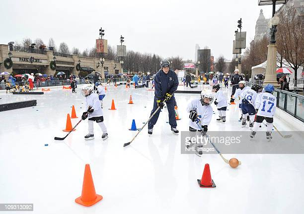Coaches from USA Hockey instruct children during a youth hockey clinic as part of Hockey Day in America at Millennium Park on February 20 2011 in...