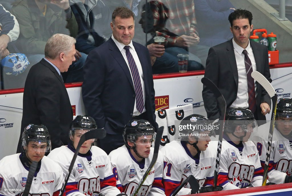 Coaches George Burnett, Eric Lindros, and Luca Caputi of Team Orr patrol the bench against Team Cherry in the 2018 Sherwin-Williams CHL/NHL Top Prospects game at the Sleeman Centre on January 25, 2018 in Guelph, Ontario, Canada. Team Cherry defeated Team Orr 7-4.