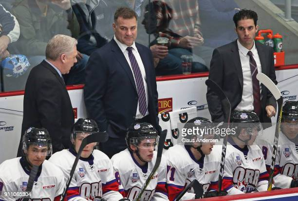 Coaches George Burnett Eric Lindros and Luca Caputi of Team Orr patrol the bench against Team Cherry in the 2018 SherwinWilliams CHL/NHL Top...