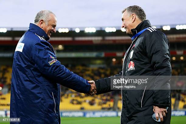 Coaches Graham Arnold of Sydney FC and Ernie Merrick of the Phoenix shake hands during the round 26 ALeague match between the Wellington Phoenix and...