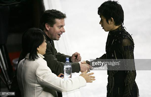 Coaches Lee Barker and Norika Oda talk to Nobunari Oda of Japan in the Men's Qualifying Free Skate during the ISU World Figure Skating Championships...