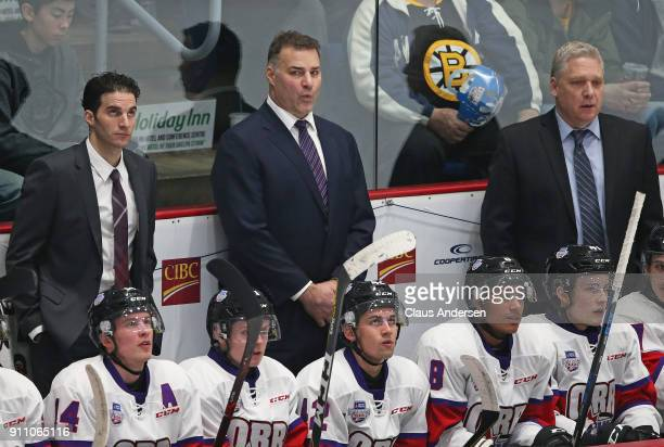 Coaches Luca Caputi Eric Lindros and George Burnett of Team Orr man the bench against Team Cherry in the 2018 SherwinWilliams CHL/NHL Top Prospects...