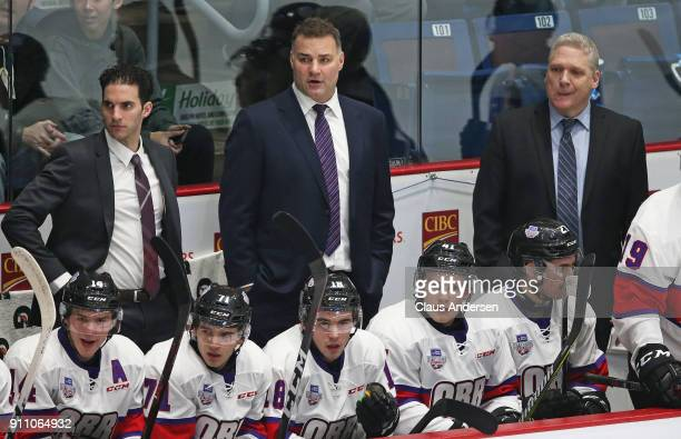 Coaches Luca Caputi Eric Lindros and George Burnett of Team Orr watch the action against Team Cherry in the 2018 SherwinWilliams CHL/NHL Top...