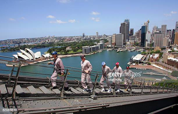 AFL coaches Mark Harvey Paul Roos Dean Laidley and Mick Malthouse follow an unidentified guide as they climb the Sydney Harbour Bridge for an AFL...