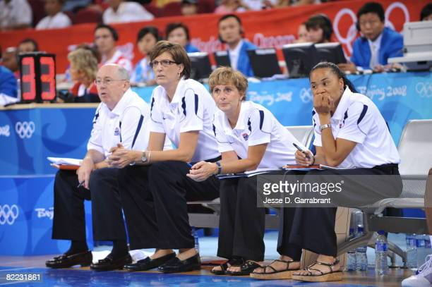 Coaches Mike Thibault, Anne Donovan, Gail Goestenkors and Dawn Staley of the U.S. Women's Senior National Team takes in the game against the Czech...