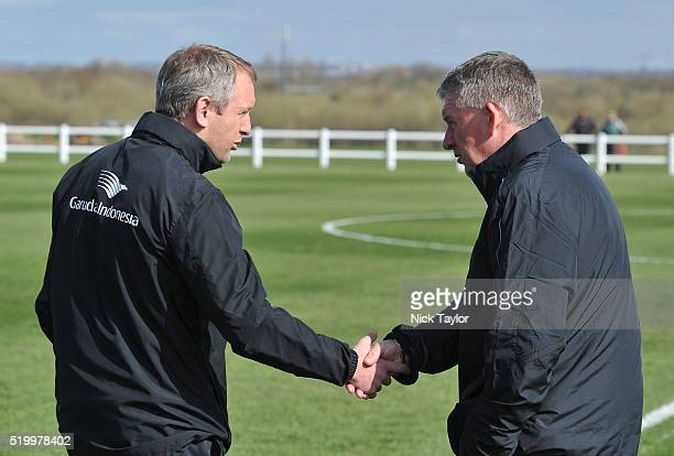 Coaches Neil Critchley of Liverpool and Kevin Sheedy of Everton shake hands before the Everton v Liverpool U18 Premier League game at Finch Farm on...