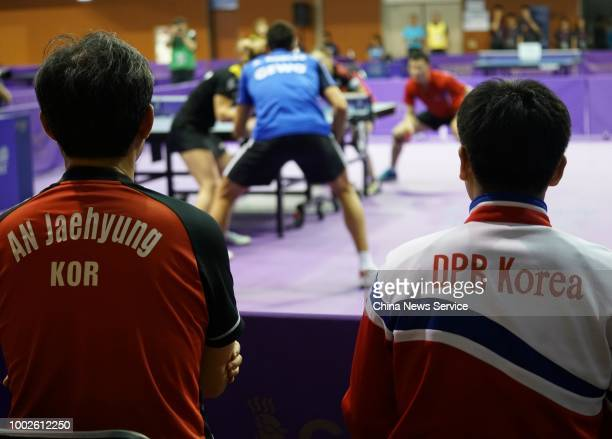 Coaches of North Korea and South Korea both coach the unified team of South Korea and DPRK in the Mixed Doubles qualifying match during the 2018 ITTF...